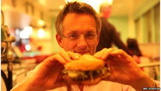 Michael Mosley tucking into a burger