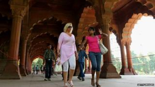 Women tourists walk through the Red Fort, Delhi