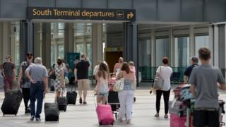 Travellers arriving at Gatwick Airport