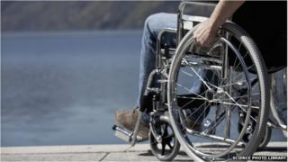 Man in a wheelchair by water