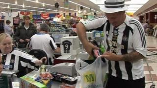 Morrison's staff in NUFC shirts