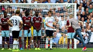 Fan takes free kick after running on to pitch at West Ham