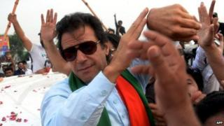 Imran Khan is mobbed by supporters during a protest march in Islamabad - 16 August 2014