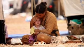 A refugee woman from the minority Yazidi sect who fled from Sinjar at a refugee camp in Qamishli August 17 2014