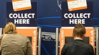 passengers at ticket machines