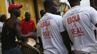 Ebola awareness campaigners stage a street performances at an event in Monrovia, Liberia - 18 August 2014