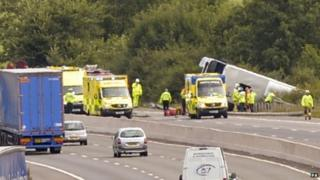 Coach crashes down ditch on M5 in Gloucestershire