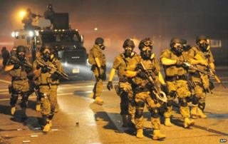 Police in riot gear patrol the streets in Ferguson, Missouri - 18 August 2014