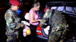Venezuelan soldiers check the boot of a car in the border city of San Cristobal, 11 Aug 14