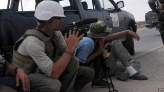 James Foley (left) film near the Libyan town of Sirte. Photo: 2011