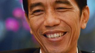 This picture taken on 30 July, 2013, Jakarta governor Joko Widodo, smiles during an interview in his office in Jakarta's city hall