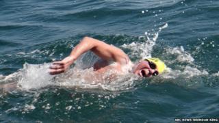 Cyril Baldock swimming in the sea