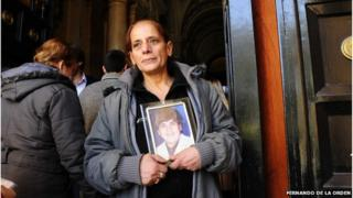 Nelida Serpico holds a picture of her son