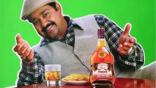 Actor Mohanlal advertises for a brand of whisky in Kerala