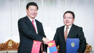 Chinese president Xi Jinping (left) met his Mongolian counterpart Tsakhiagiin Elbegdorj on Thursday