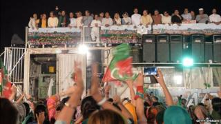 Imran Khan on top of a shipping container