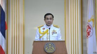 A handout photo made available by the Thai government show Thai military junta head and newly appointed Prime Minister General Prayuth Chan-ocha reading a statement after he received the Royal command at the Army headquarters in Bangkok, Thailand, 25 August 2014