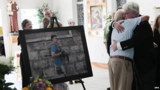 John Foley (R), father of James Foley, hugs a man during a memorial service for slain US journalist James Foley in Rochester, New Hampshire
