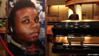 A painting of Michael Brown is displayed in front of his coffin during his funeral on 25 August.