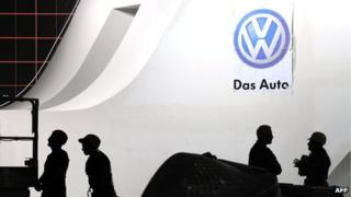 Workers at the Volkswagon stand at the Shanghai New International Expo Center