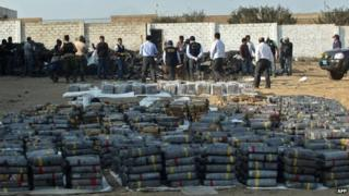 Picture showing policemen taking part in the destruction of part of at the more than three tonnes of cocaine seized in Trujillo on 26 August, 2014