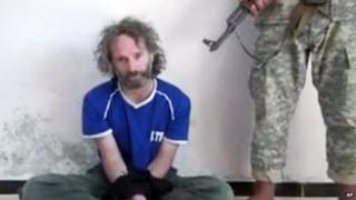 A still from a video of journalist Peter Theo Curtis taken during his imprisonment by al-Qaeda affiliates