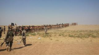 Photo posted online purportedly showing Syrian army soldiers in their underwear being led through the desert by Islamic State fighters (27 August 2014)