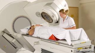Radiotherapist watching a patient