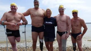 Relay team on the beach in Dover