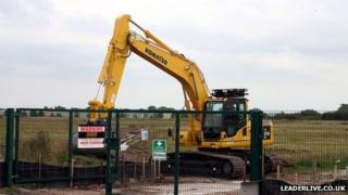 A digger on the proposed Wrexham prison site