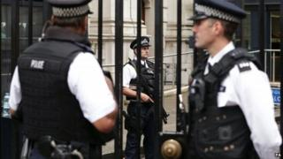 Armed police officers on duty at Downing Street, London