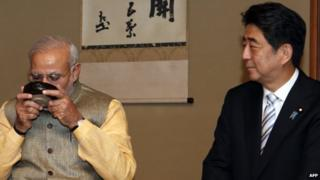"Paper say PM Narendra Modi (left) and his Japan counterpart Shinzo Abe are ""good friends"""