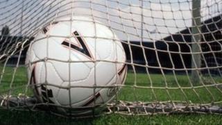 football in a goal net.