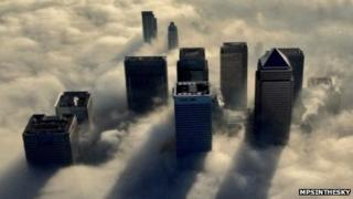 London office blocks shrouded in clouds