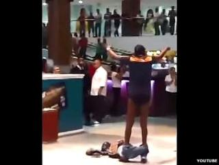 Man strips in shopping mall in Brazil