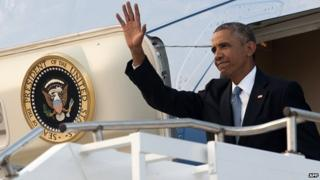 US President Barack Obama waves as he disembarks from Air Force One upon arrival at RAF Fairford in Gloucestershire