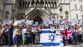 Protesters gathered outside the Royal Courts of Justice in London