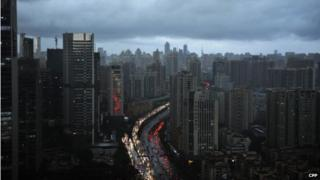 Dark clouds cover the city's skyline on 22 May 2014 in Guangzhou, Guangdong Province of China.