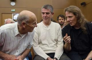 Greenpeace activists Peter Wentt (L), Jean-Michel Vougere (C) and Eddy Varin (R) talk in a courthouse in Colmar, eastern France, 4 September