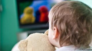 A toddler watching TV