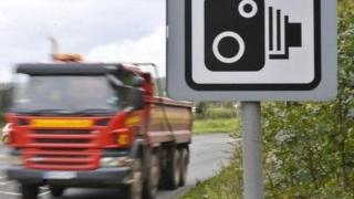 Lorry passing speed camera sign
