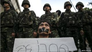 A Thai protester shows his disapproval with the military during an anti-coup protest despite the martial law 23 May 2014 in Bangkok, Thailand.