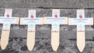 Remembrance crosses placed around the Memorial Cross in Newington