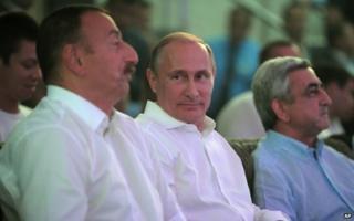 Russian President Vladimir Putin (centre) with Azerbaijani President Ilham Aliyev (left) and Armenian President Serge Sarkisian in Sochi, 9 August