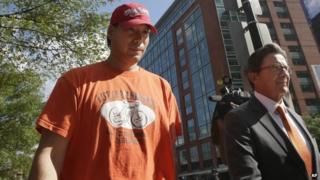 Glenn Adam Chin, left, a former supervisory pharmacist at the New England Compounding Center, walks with his attorney Paul Shaw, right, after appearing in federal court, 4 September 2014