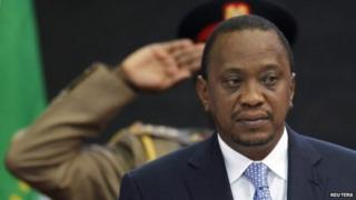 "Kenya""s President Uhuru Kenyatta stands for Kenya""s national anthem before the Africa Union Peace and Security Council Summit on Terrorism at the Kenyatta International Convention Centre in Nairobi, September 2, 2014"