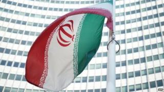An Iranian flag waves in a wind outside the Vienna International Centre in July 2014