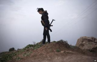 A female Kurdish fighter in northern Syria around 3 March 2014