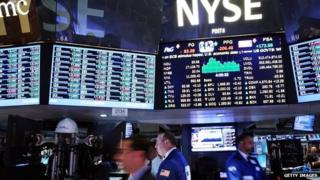 Traders work on the floor of the New York Stock Exchange (NYSE) in New York City, 26 August 2014