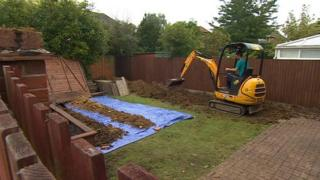 Digger excavates a Cambridgeshire garden in connection with Deborah Steel disappearance